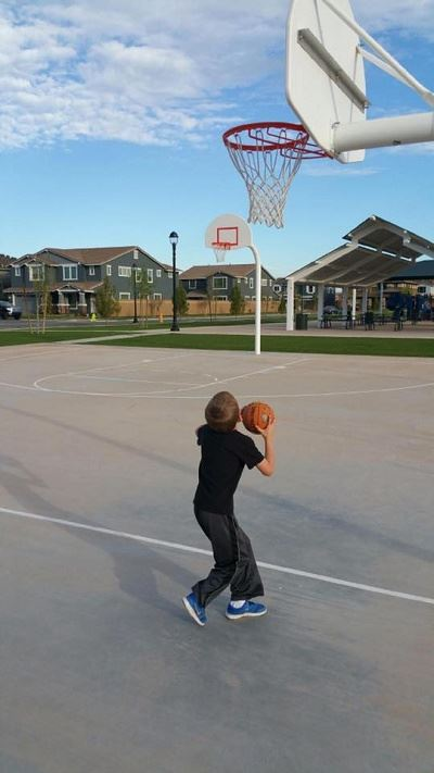 Young Boy Shooting Hoops