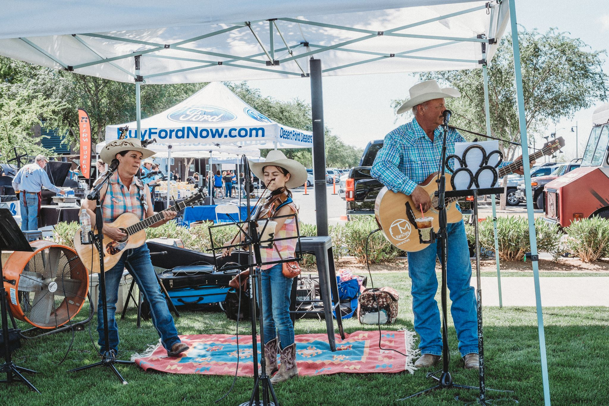 Trio of Country Musicians Play Under a Tent