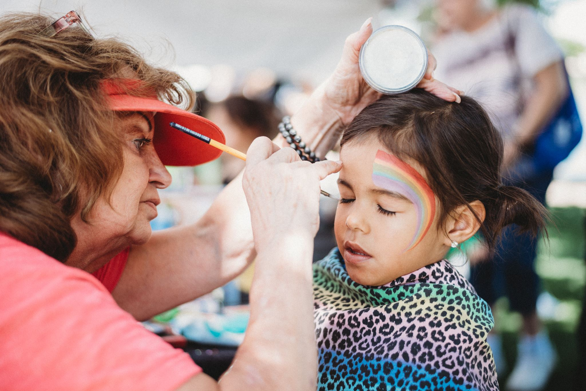 Young Girl Getting a Rainbow Painted on Her Face