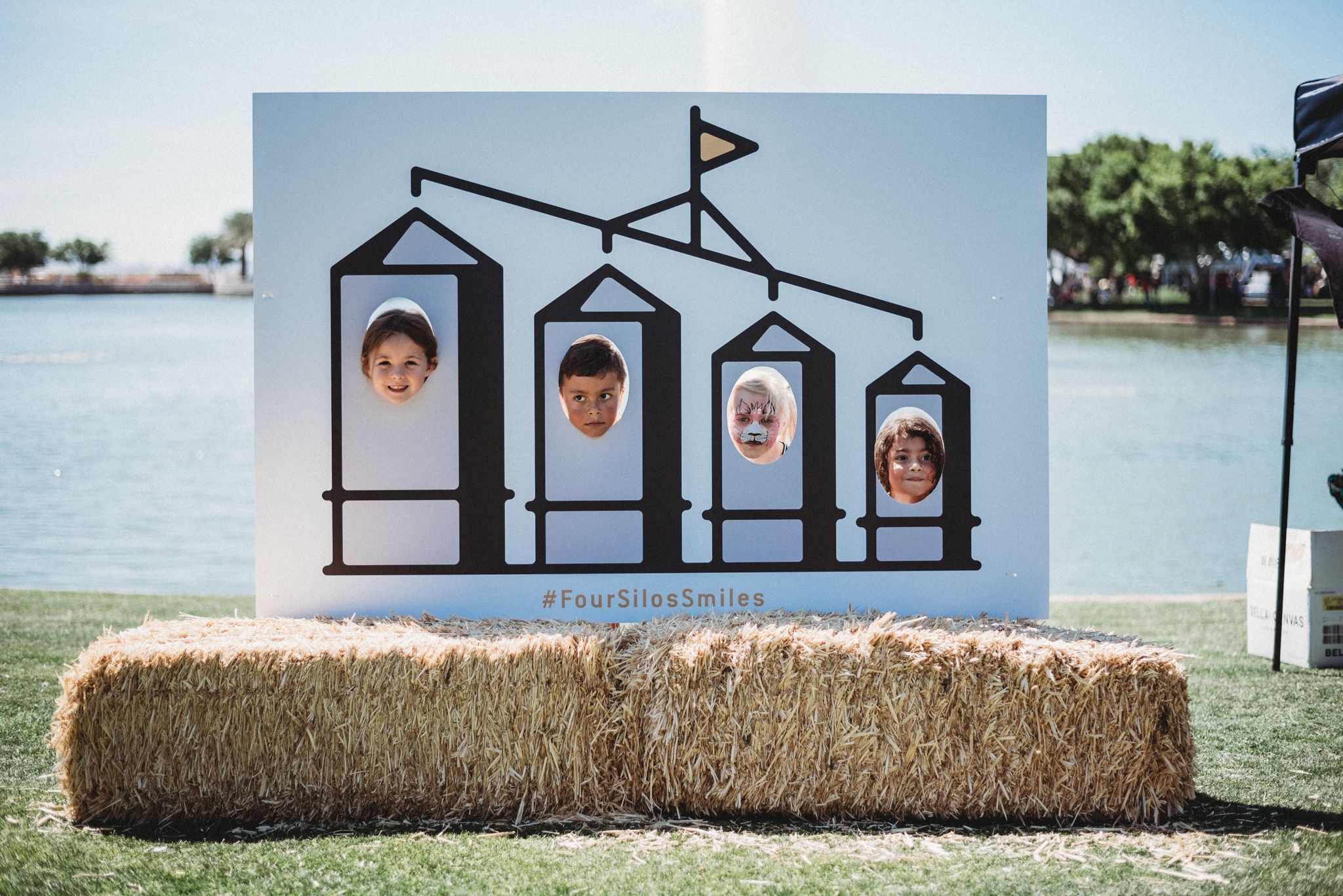 Four Children Pose Behind a Silo Stand up