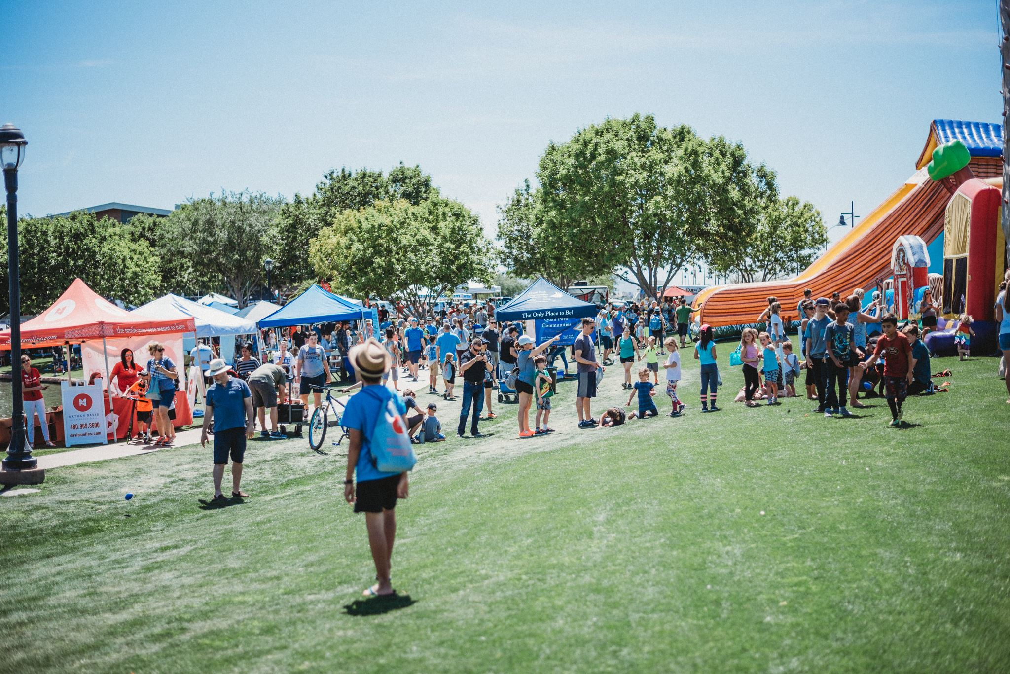 Wide Shot of Vendor Tents and Inflatables