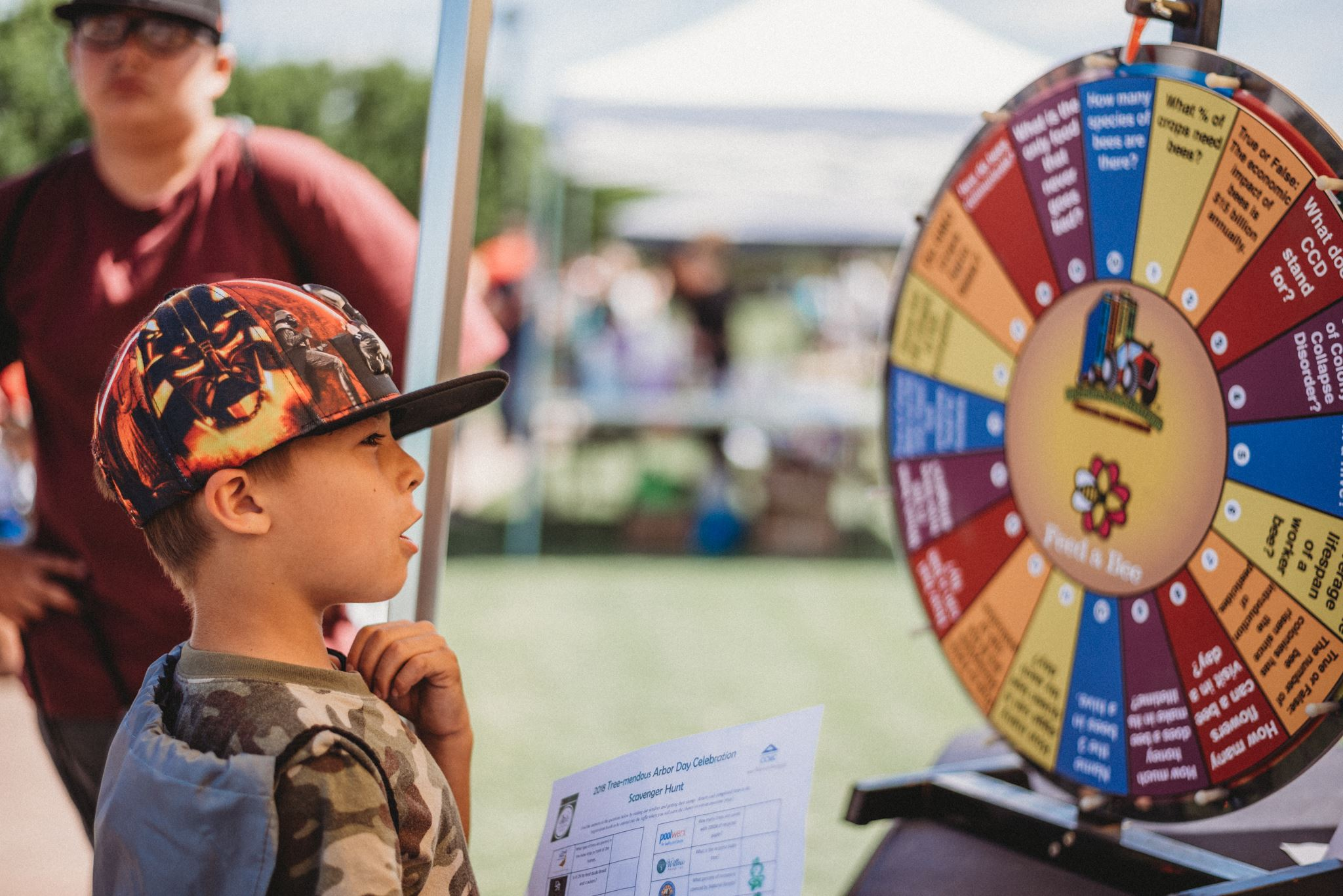 Young Boy Reading a Trivia Wheel