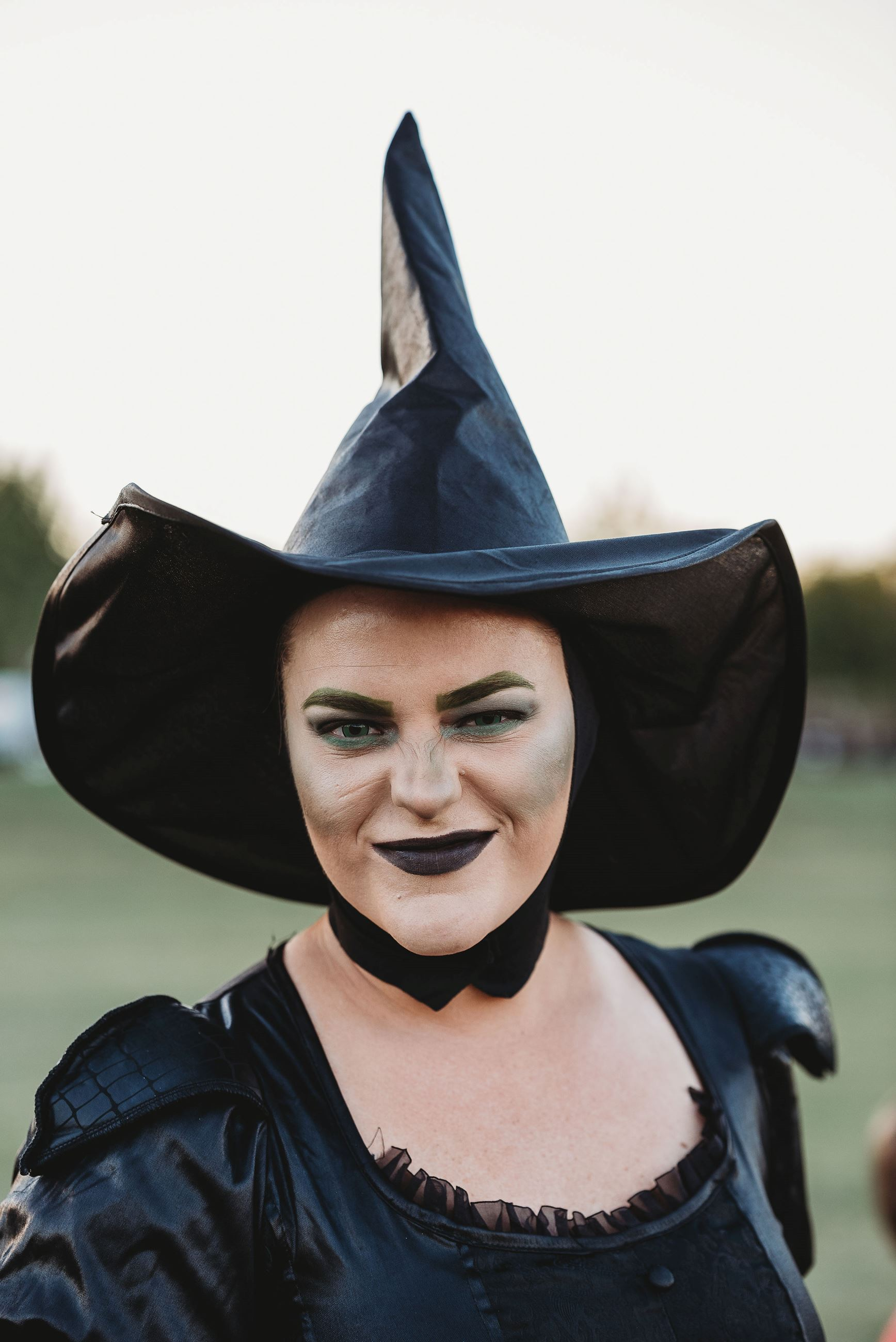 Woman Dressed as a Witch Gives a Wicked Grin at the Camera