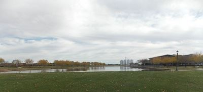 Wide Shot of a Pond on a Partly Cloudy Day