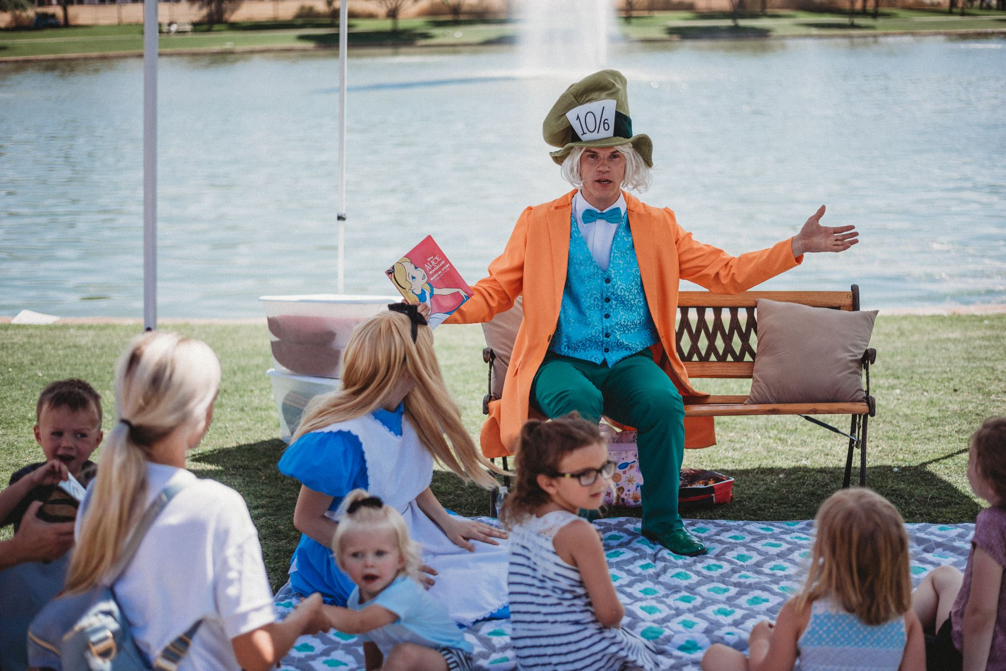 Man Dressed as the Mad-Hatter from Alice in Wonderland Holding Out His Arm