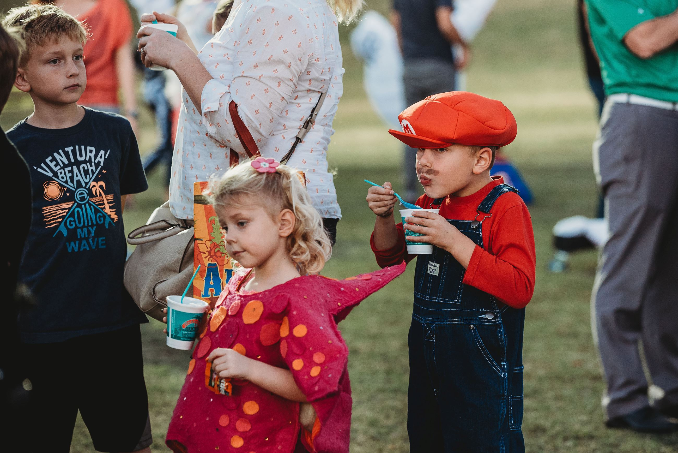 Little Boy Dressed as Mario and His Sister Eating Shaved Ice