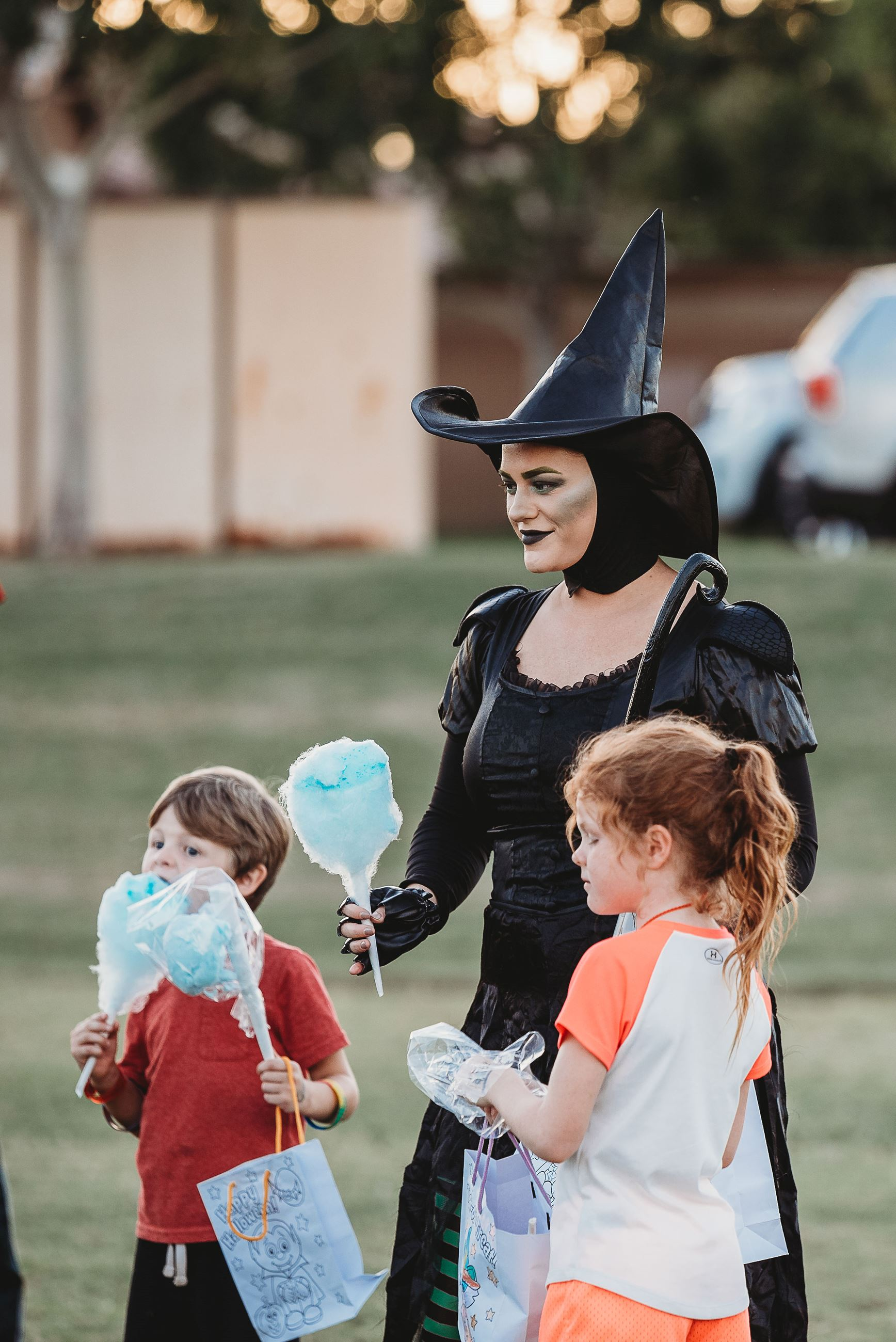 Mother Dressed as a Witch with Her Kids, All Eating Blue Cotton Candy